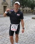 Auditel�s Ironman Alan Ford raises more than £2,000 for Cancer Research